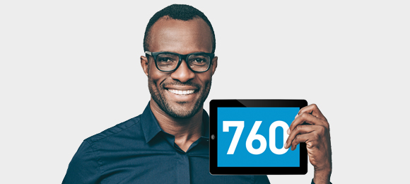 Image of man holding tablet with a credit score of 760 displayed.