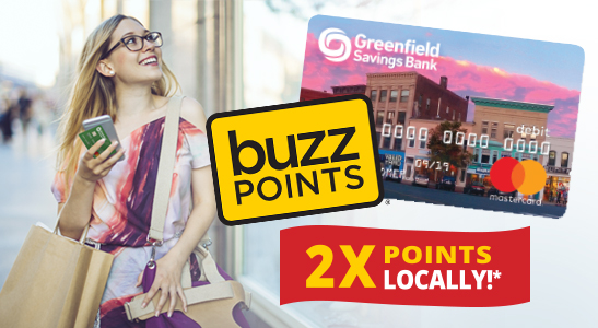 Woman walking with bags. Greenfield Savings Bank Debit Card, Buzz Points logo, 2x points locally*