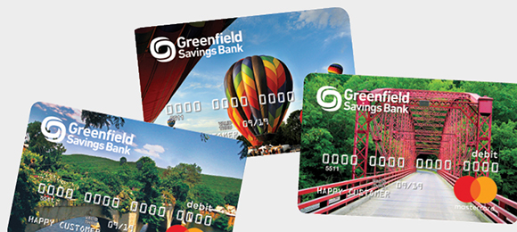 Three scenic debit card images. Shelburne Bridge of Flowers, hot air balloons, Bardwell's Ferry Bridge.