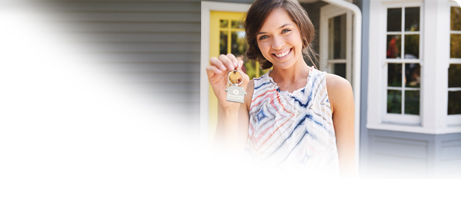 Woman holding keys to a new home with a GSB Homebuyer's Club keychain.