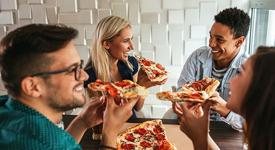 A group of friends enjoying pizza.