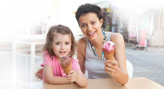 Mother and daughter holding ice cream cones