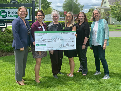 Micro-loan check presentation for community loan program by Greenfield Savings Bank