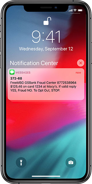 Mobile phone text alert from Greenfield Savings Bank's automated debit card fraud protection service.