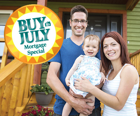 Buy in July Mortgage Special at Greenfield Savings Bank. Happy family standing in front of new home.